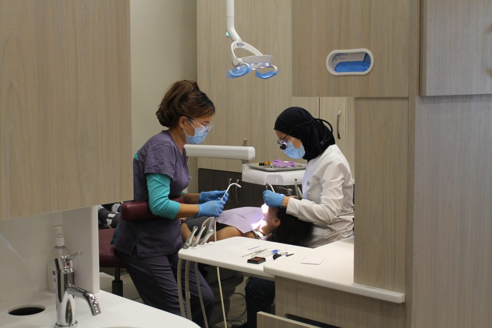 The dentist Manar Rashid Working with Patient In Orleans At Morningstar