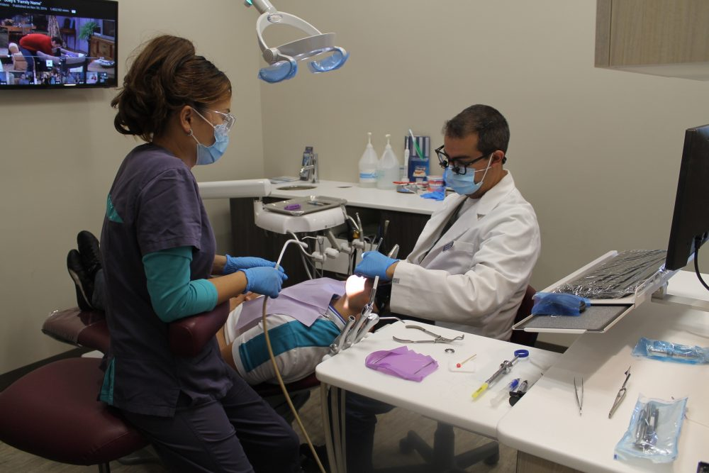 The Dentist Dr.Ahmad Al-Attar Working With Patient in Orleans